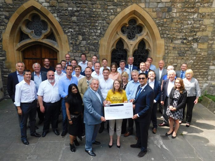bacta, the UK trade association, presents a cheque for £30,000 to the Rays of Sunshine UK charity