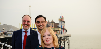 Anne Martin, Chief Executive Officer, The Brighton Pier Group plc, receives the Bacta Community Award from Bacta Chief Executive, John White (left) and Bacta President, Gabi Stergides