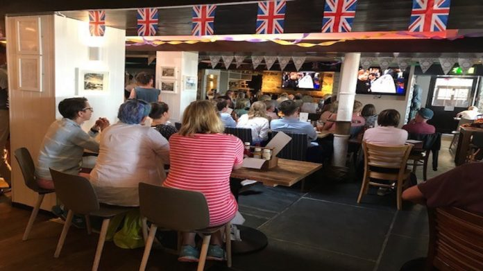 Locals watch the royal wedding at the Lifeboat Inn in St Ives, Cornwall